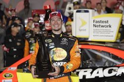 Martin Truex Jr. celebrates after winning Sunday's Coca-Cola 600 at Charlotte Motor Speedway in a record-breaking performance.
